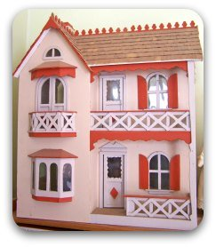 a child's storybook pink doll's house