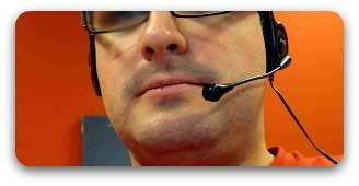 Male call center worker on phone.