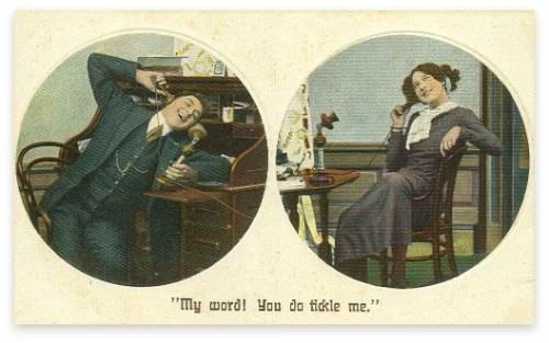 A man and a women talking on candles stick telephones - image circa 1910