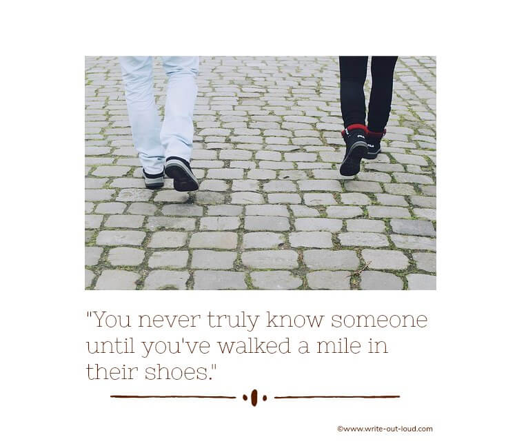 The legs and feet of two people walking on cobbles with text: You never truly know someone until you've walked a mile in their shoes.