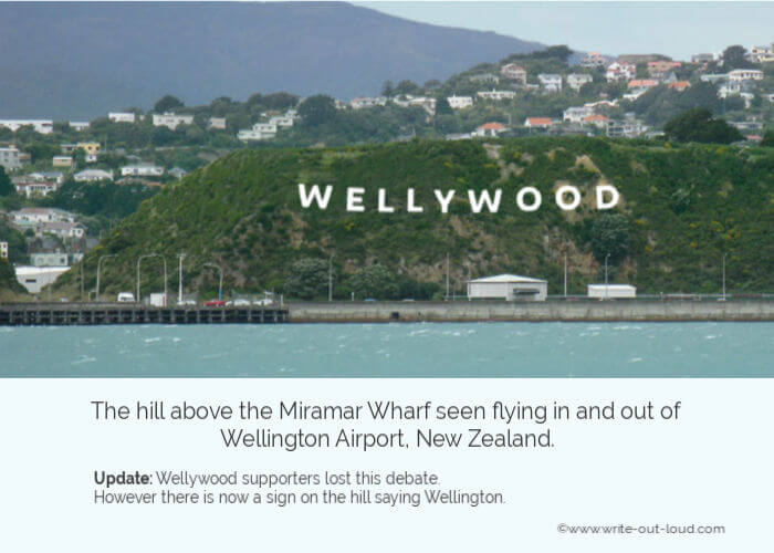 Image -The hill above Miramar Wharf, Wellington, NZ with a sign saying Wellywood.