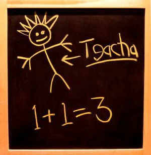 child's blackboard with stick figure and 1 +1 = 3