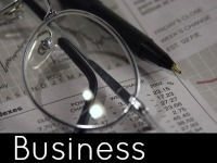 A pair of glasses on top of a stock report - business speech topics.