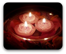 Three lit floating candles