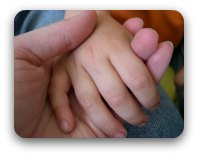 A child's hand in mothers