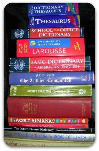 A stack of dictionaries, thesaurus and other reference texts.