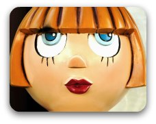 A stereotypical doll's face