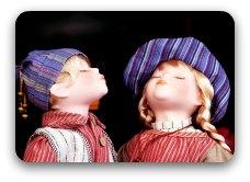 Two dolls preparing to kiss