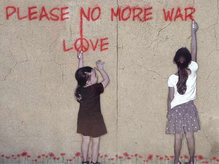 Image- street art- two girls writing on wall - please no more war. Love.