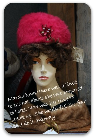 1950's mannequin with a red hat