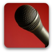 black microphone on red backgroun