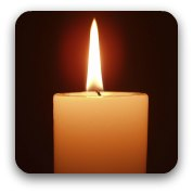 A single white candle burning