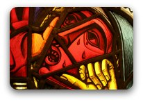 Stained glass window detail of a man suffering