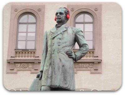 A statue waering a pair of red headphones