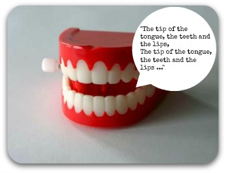 A set of wind up toy teeth
