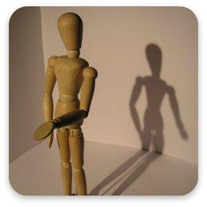 A wooden mannequin rehearsing a speech