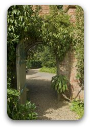 An archway leading to a beautiful garden