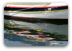 Reflections of a boat in water