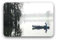 Canoe on lake in mist