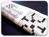 Folded newspaper showing crossword