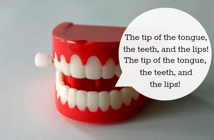 Image: a set of plastic wind up teeth with a speech balloon containing an articulation drill.
