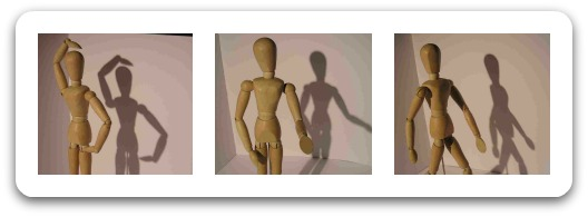 Trio of wooden mannequins illustrating gesture