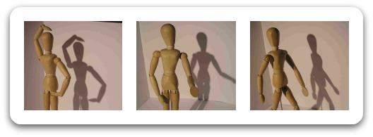 Trio of wooden mannequins illustrating gesture